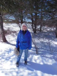 Healthy Peninsula founder standing in snow