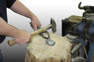 Hammering metal