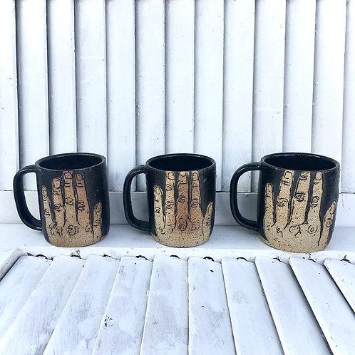 Volcanic Black Hand Mugs