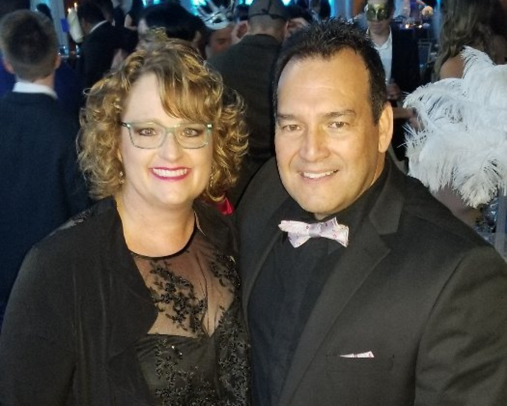 Linda and Rick Crosby in formal wear at a conference.