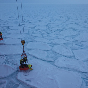 A team of scientists working to put probes on the pancake ice