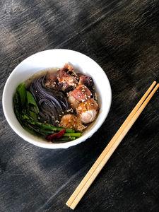 Pork ball and black noodle bowl
