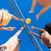 Adult League Beach Volleyball Game