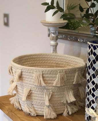 Cream tassel storage basket
