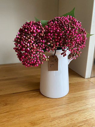White planter with artificial viburnum flower buds