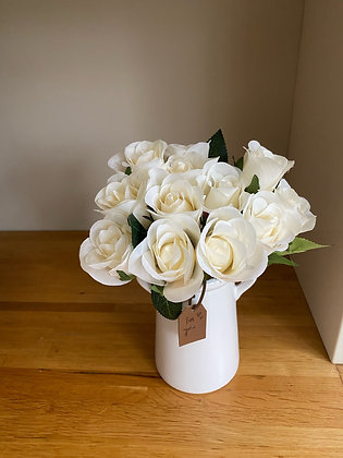 White planter with artificial ivory rosebud bundle