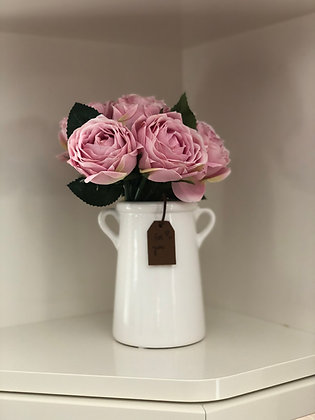 White planter with artificial pink roses