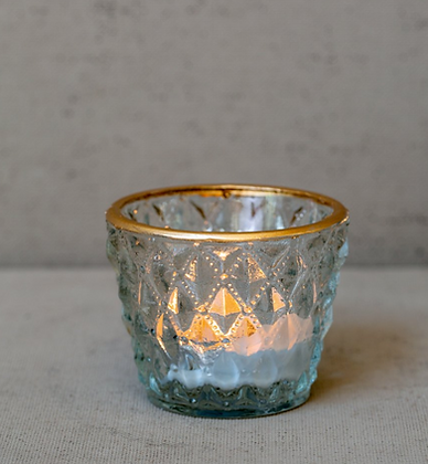 Gold rim tea light holder with pressed diamond detailing
