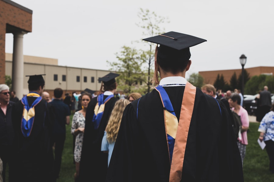 students on graduation day with picture taken from behind
