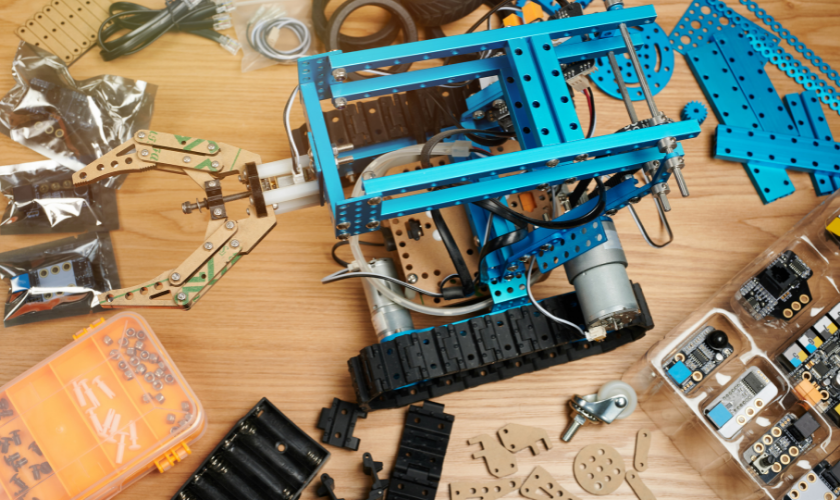 blue components for building a robot on a wood table