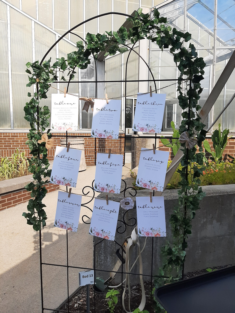 Wedding Reception seating charts with trellis at the MSU Horticulture Gardens. Music by Rondo String Quartet. www.RondoStringQuartet.com