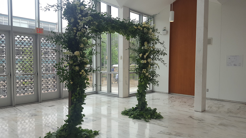 Wedding alter flowers by Parsonage Events at McGregor Conference Center, Wayne State, Detroit, Michigan
