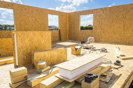 Assembling a small house of SIP panels.jpg