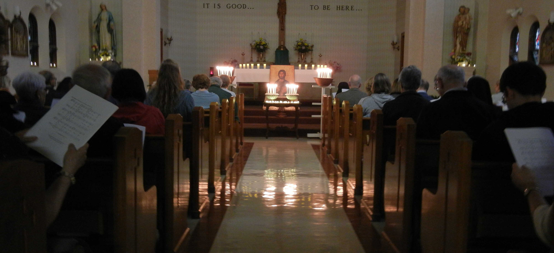 all of the candles stand in front of the chapel