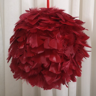 red feather ball