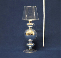silver and clear candle holder