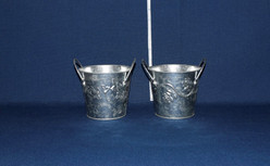 small galvanized pales with flowers