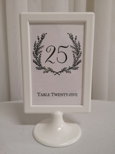 white frame on stand 9x5