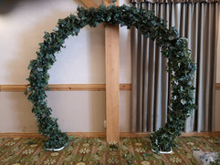 round arch and greenery