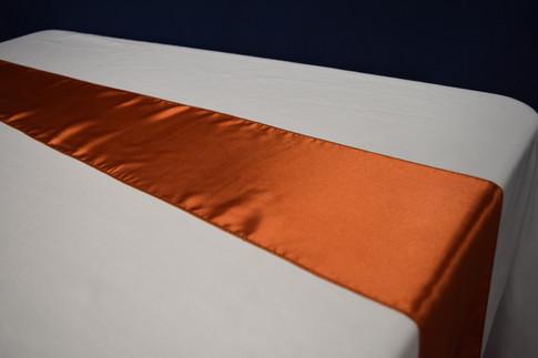 burnt orange runner or chair tie