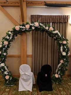 round arch with flowers and greenery
