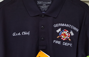 Polo shirt with embroidered fire department insignia