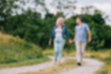 elderly-couple-walking-on-the-path-PSBNJ