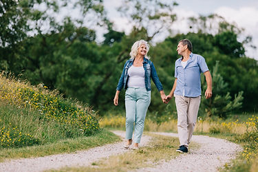 elderly-couple-walking-on-the-path-PSBNJ