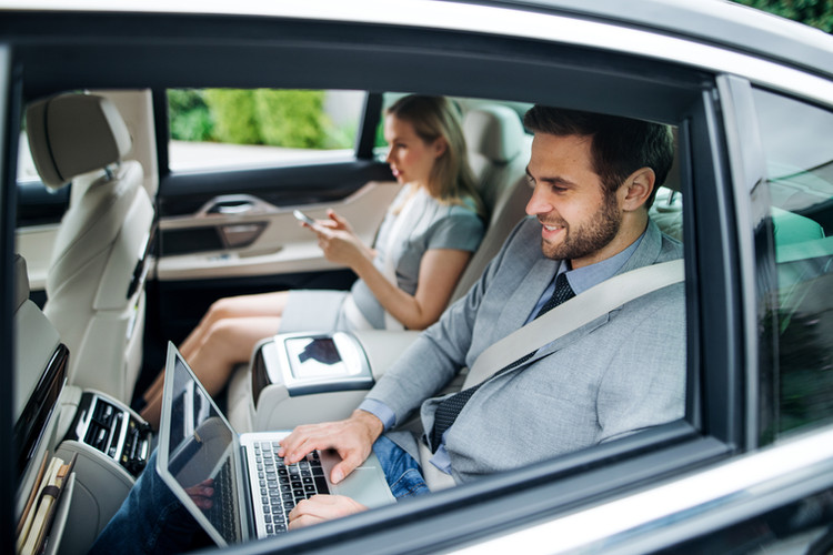 business-couple-with-laptop-sitting-on-b