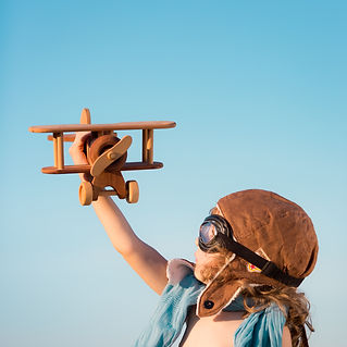 happy-kid-playing-with-toy-airplane-PJSZ