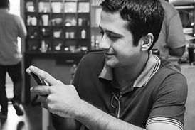 young-adult-happy-texting-on-his-mobile_
