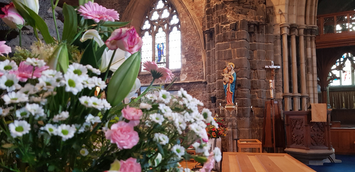 Our Lady and flowers