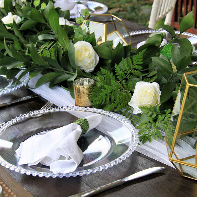 Greenery and white roses wedding centerp
