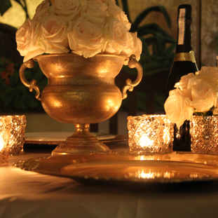Gold and peach roses wedding centerpiece