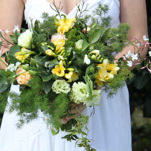 Yellow freesia, lisianthus and  roses br