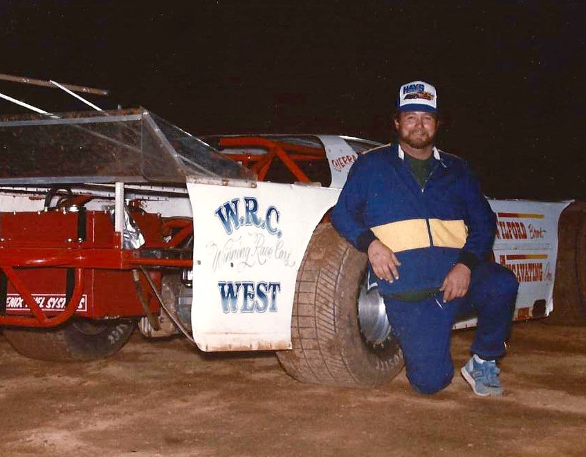 DT posing next to WRC car in pville  inf