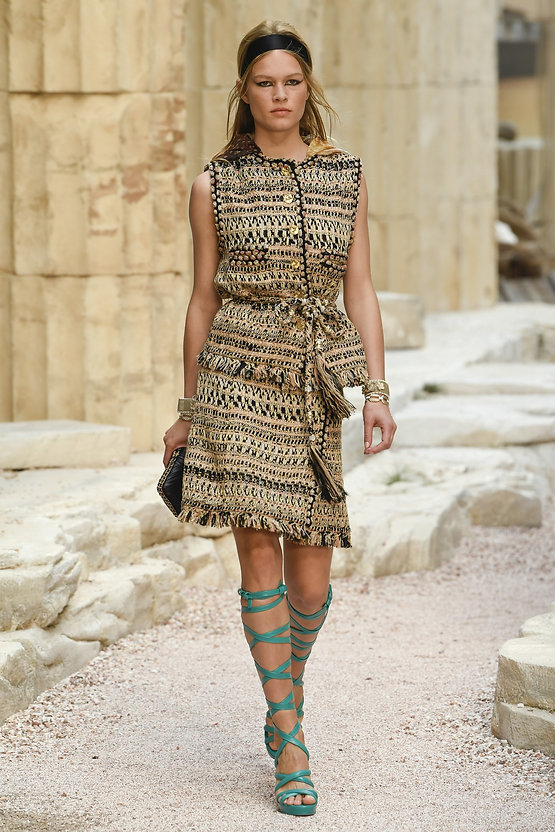 8b6831b746 Image Source  Photograph of a model wearing a tweed Chanel ensemble for  Karl Lagerfeld s  Modernity of Antiquity  Cruise 2018 collection. Yannis  Vlamos.