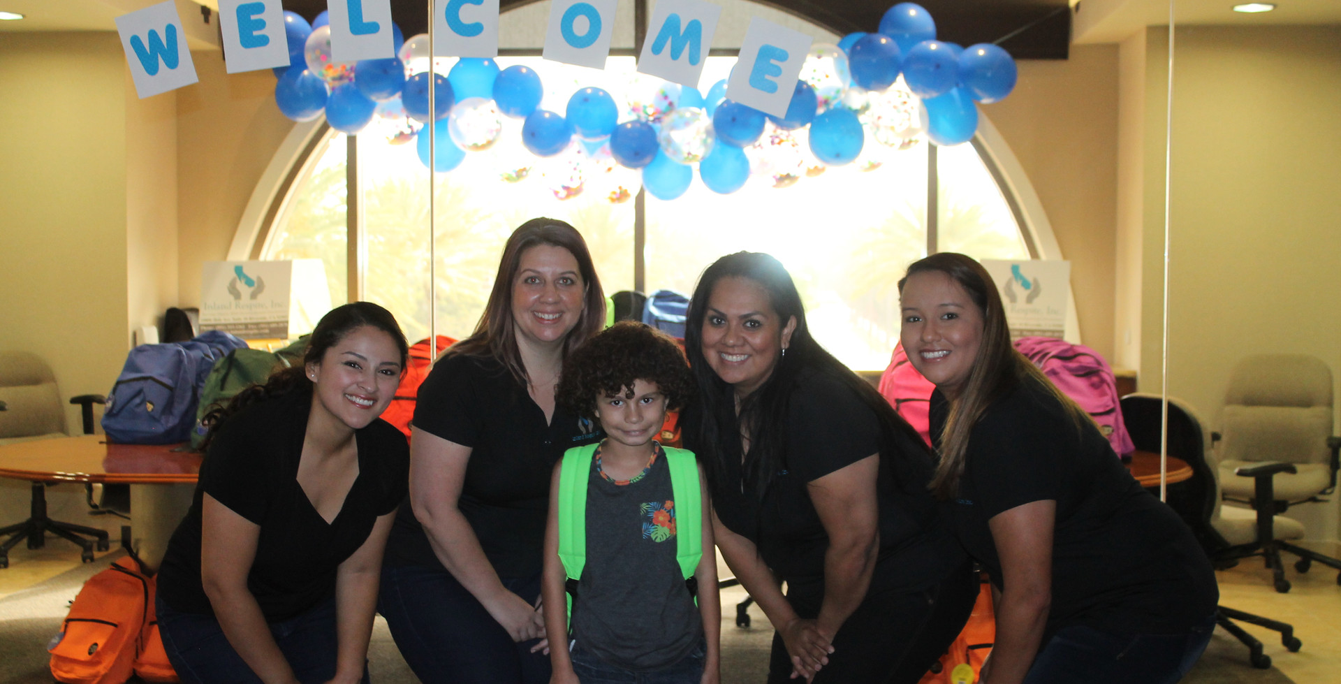 School Backpack Giveaway Participant and Inland Respite Team