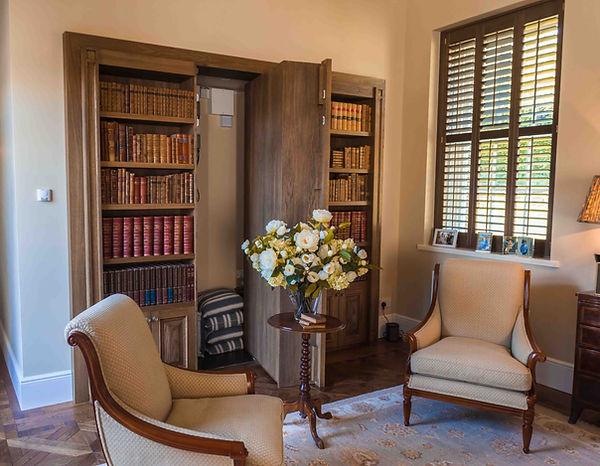 Pivoting door bookcase