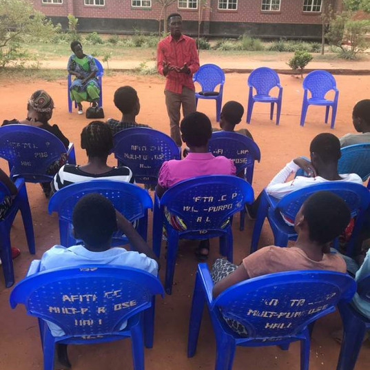 Tim preaching to the students