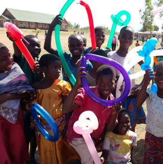 Creating balloon animals with the children