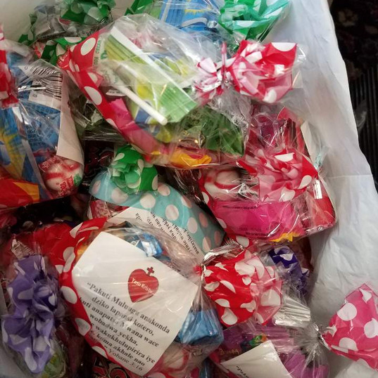 Goody bags filled with treats & bible verse of John 3:16