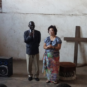 Sung giving testimony at church of Malawian prison