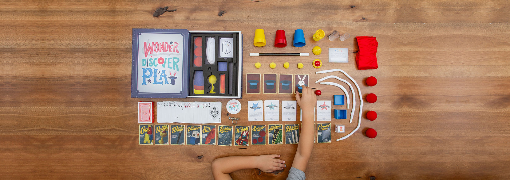 Birds eye view of the entire magic set. Each kit comes with magic tricks, magic wand, magic cards, magic rope, magic balls, magic cups, magic cloth and much more. Magic Set for Kids and Magic Kit for Kids by Johnny Magic.