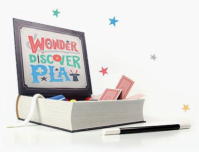 Open box of magic set showing magic wand, magic cards, magic rope, magic cups, magic stars, magic set an magic kit for kids.