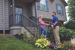 dealer-greeting-customer-on-porch.jpg