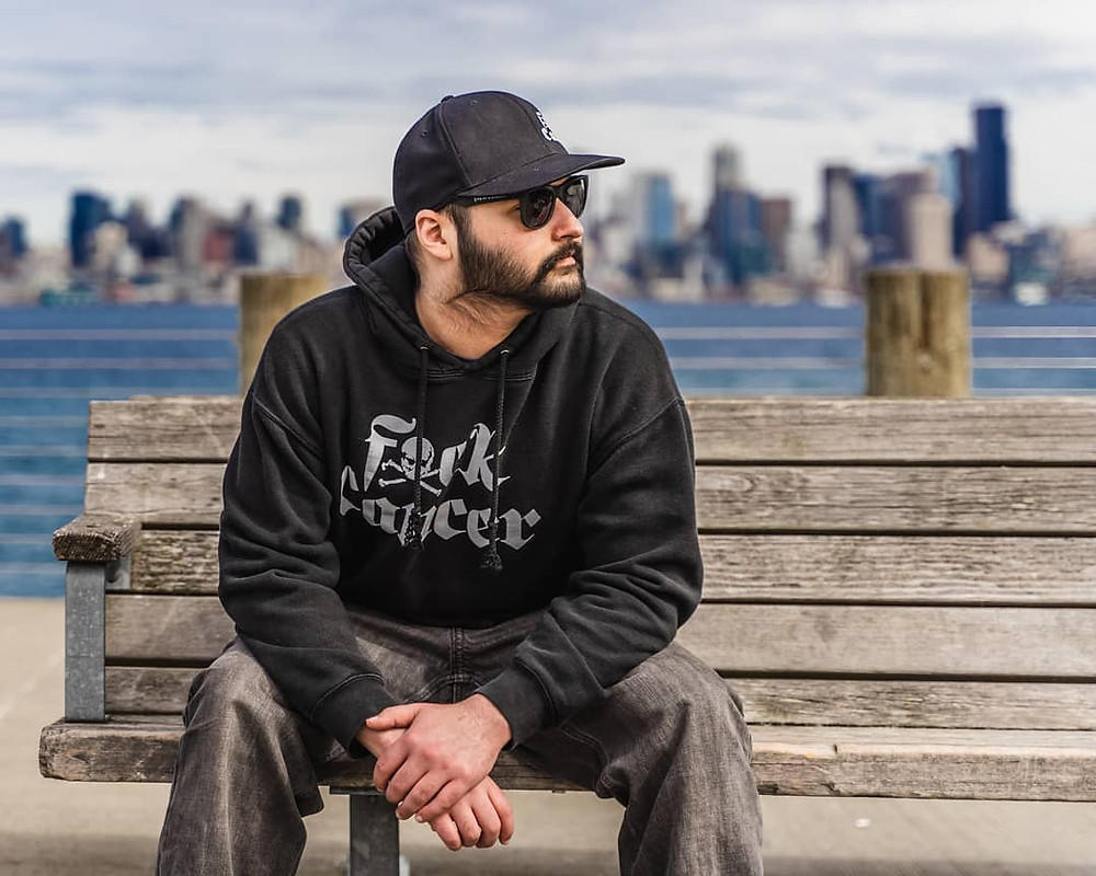 Zach rocking the @fxckcancer baseball cap, sunglasses, and hoodie. Photo credit Mike Baltierra Photography