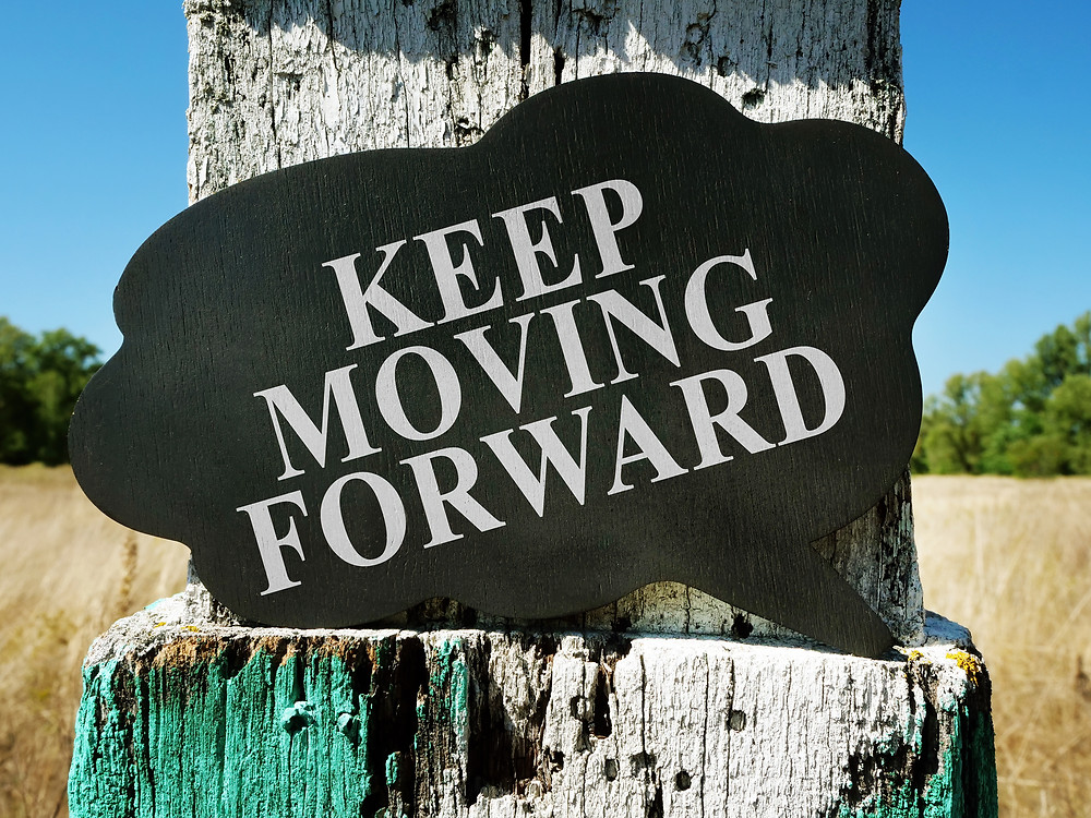 Image: Sign that says Keep Moving Forward
