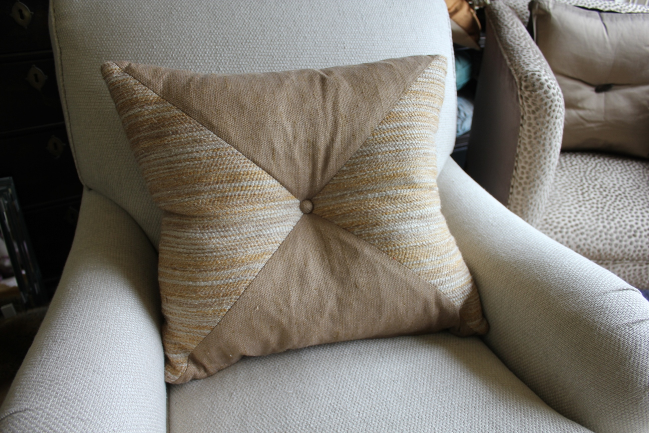 14. Standard square cushion with panel fabric and small button