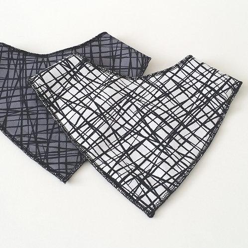 White & black scaffold print dribble bib